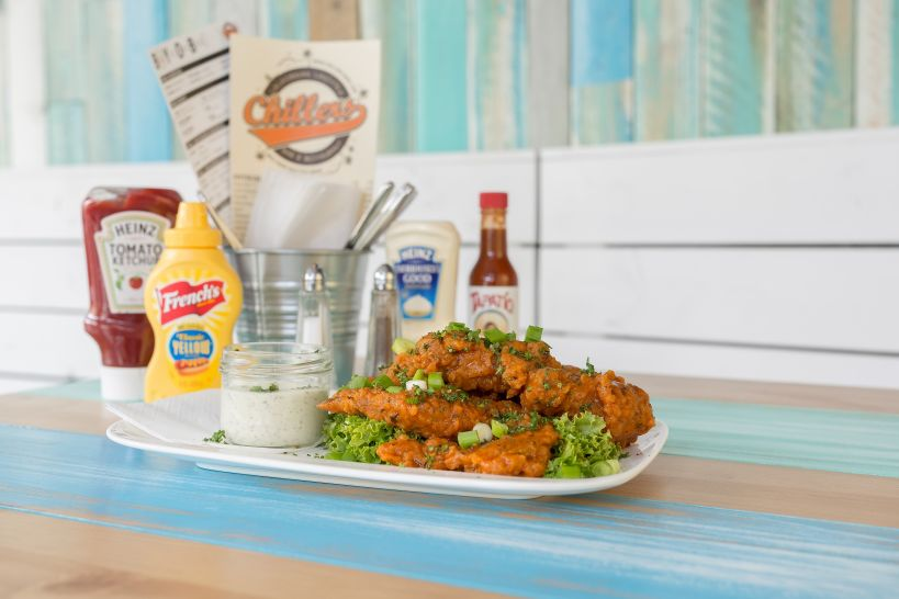 Traditional Chicken Wings, paniert, mariniert in Californian Jerk Hot Sauce und Ranch Dip